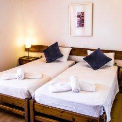 Folies Corfu Town Hotel Apartments Корфу комната для гостей фото 5
