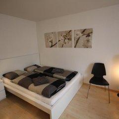 Апартаменты Letzigrund Apartments комната для гостей фото 4