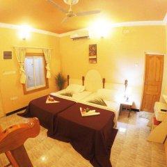 Отель Гостевой Дом Wavoe Inn Мальдивы, Северный атолл Мале - отзывы, цены и фото номеров - забронировать отель Гостевой Дом Wavoe Inn онлайн комната для гостей фото 3