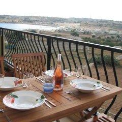 Отель SeaView Apartment in Saint Thomas Bay Мальта, Марсаскала - отзывы, цены и фото номеров - забронировать отель SeaView Apartment in Saint Thomas Bay онлайн балкон
