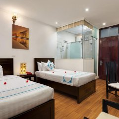 Hanoi Focus Boutique Hotel 3* Семейный номер Делюкс разные типы кроватей фото 8