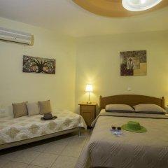Апартаменты Lyristis Studios & Apartments комната для гостей фото 5
