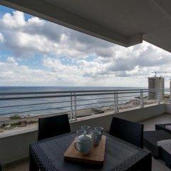 Отель Seafront Apartment Sliema Мальта, Слима - отзывы, цены и фото номеров - забронировать отель Seafront Apartment Sliema онлайн балкон