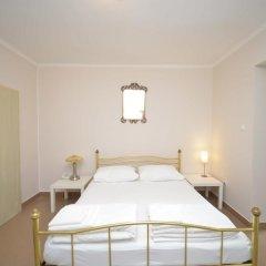 Апартаменты Tianis Apartments комната для гостей фото 5