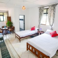 Отель M Home Guest House Стандартный номер с различными типами кроватей фото 3