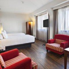 Отель NH Milano Touring 4* Улучшенный номер разные типы кроватей фото 34
