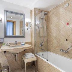 Отель NH Milano Touring 4* Стандартный номер разные типы кроватей фото 10