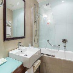 Отель NH Milano Touring 4* Стандартный номер разные типы кроватей фото 9