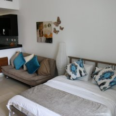 Отель Signature Holiday Homes - Botanica комната для гостей