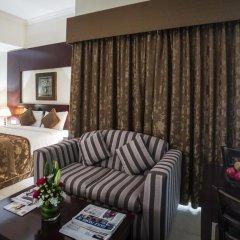 Отель Arabian Dreams Deluxe Hotel Apartments ОАЭ, Дубай - отзывы, цены и фото номеров - забронировать отель Arabian Dreams Deluxe Hotel Apartments онлайн комната для гостей фото 4