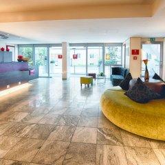 Отель Leonardo Hotel & Residenz München Германия, Мюнхен - 11 отзывов об отеле, цены и фото номеров - забронировать отель Leonardo Hotel & Residenz München онлайн интерьер отеля