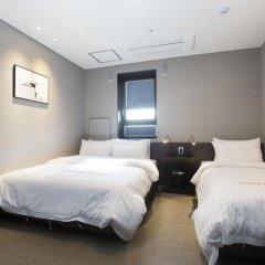Отель Grid Inn 2* Стандартный номер с различными типами кроватей фото 4