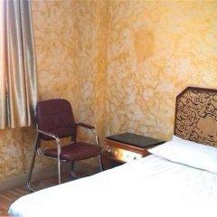Zhongshan Yongyi Hotel комната для гостей