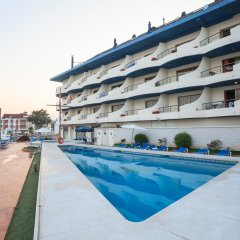 Отель Astuy Apartamentos Арнуэро бассейн фото 2