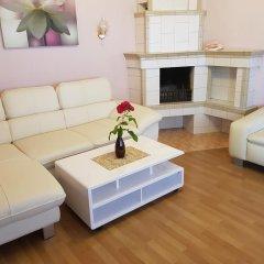 Апартаменты Naiza Guesthouse and Apartments комната для гостей фото 2
