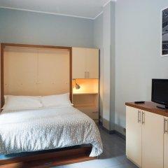 Отель Aparthotel Navigli Италия, Милан - отзывы, цены и фото номеров - забронировать отель Aparthotel Navigli онлайн удобства в номере фото 2