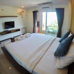 Отель Benjamas Place Номер Делюкс с различными типами кроватей фото 6