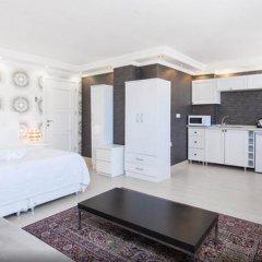 Отель Defne Suites Улучшенные апартаменты с различными типами кроватей фото 32