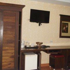 Отель Queen Victoria Inn. удобства в номере
