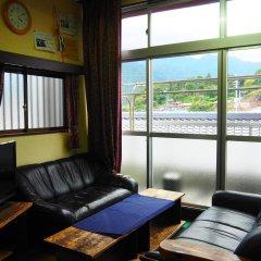 Отель Sudomari Minshuku Friend 2* Кровать в мужском общем номере фото 3