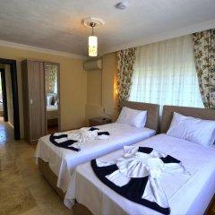 Villa Kelebek Oz Турция, Патара - отзывы, цены и фото номеров - забронировать отель Villa Kelebek Oz онлайн комната для гостей фото 2