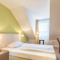 Отель Ramada by Wyndham München Airport 3* Стандартный номер с различными типами кроватей фото 6