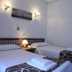 Отель Hostal Esmeralda Стандартный номер с различными типами кроватей фото 12