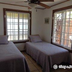 Отель Reef Point Beach House Гондурас, Остров Утила - отзывы, цены и фото номеров - забронировать отель Reef Point Beach House онлайн комната для гостей фото 2