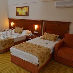 Отель Laphetos Beach Resort & Spa - All Inclusive комната для гостей