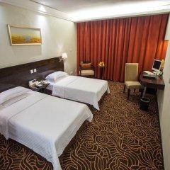 Huashi Hotel комната для гостей фото 2