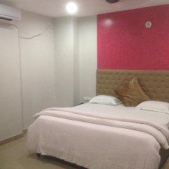 Отель The Ambassador Inn Улучшенный номер с различными типами кроватей
