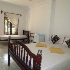 Отель Jungle Holiday Home Хиккадува комната для гостей фото 2