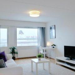 Апартаменты Kotimaailma Apartments Helsinki комната для гостей фото 5