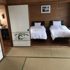 Отель Crystal Inn Onna Центр Окинавы сейф в номере