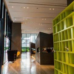 Отель The Cozy@The Base Pattaya интерьер отеля