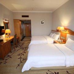 Guangzhou Hotel 3* Стандартный семейный номер с разными типами кроватей