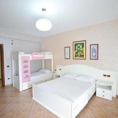 Iliria Internacional Hotel 4* Стандартный семейный номер с двуспальной кроватью фото 4