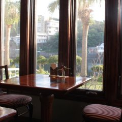 Отель La Isla Tasse Япония, Якусима - отзывы, цены и фото номеров - забронировать отель La Isla Tasse онлайн гостиничный бар