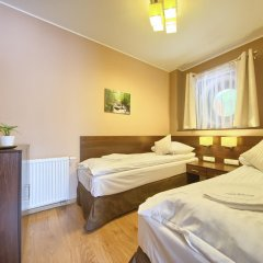 Апартаменты SKY Apartments VisitZakopane комната для гостей