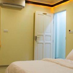 Отель Beverly Park Inn Мале комната для гостей фото 4