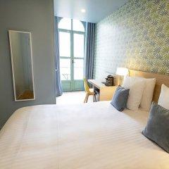 Отель Hôtel Du Centre 2* Улучшенный номер с различными типами кроватей фото 12