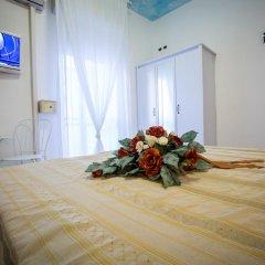 Hotel Caraibi Римини в номере