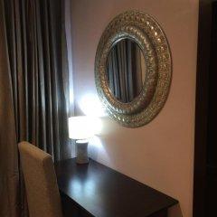 Отель Tivoli Garden Ikoyi Waterfront Нигерия, Лагос - отзывы, цены и фото номеров - забронировать отель Tivoli Garden Ikoyi Waterfront онлайн удобства в номере фото 2