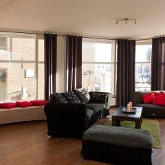 Отель Old City Centre apartments - Damrak building Нидерланды, Амстердам - отзывы, цены и фото номеров - забронировать отель Old City Centre apartments - Damrak building онлайн комната для гостей фото 5
