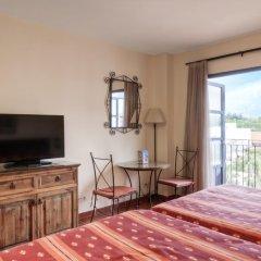Отель PortAventura Hotel El Paso - Theme Park Tickets Included Испания, Салоу - 12 отзывов об отеле, цены и фото номеров - забронировать отель PortAventura Hotel El Paso - Theme Park Tickets Included онлайн комната для гостей фото 2