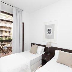 Апартаменты Happy Apartments Barcelona комната для гостей
