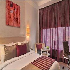 Отель The Ashtan Sarovar Portico Индия, Нью-Дели - отзывы, цены и фото номеров - забронировать отель The Ashtan Sarovar Portico онлайн комната для гостей