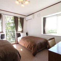 Отель Pension Angelica Минамиогуни комната для гостей