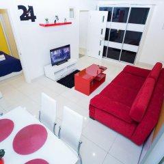 Апартаменты Central Minsk Apartments комната для гостей фото 4