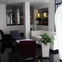 Отель Hôtel Kyriad Saint Quentin en Yvelines - Montigny Франция, Монтиньи ле Бретоне - отзывы, цены и фото номеров - забронировать отель Hôtel Kyriad Saint Quentin en Yvelines - Montigny онлайн интерьер отеля фото 3